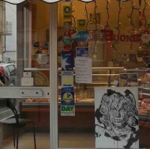 Una delle opere in vetrina in corso Piave